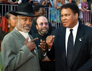 Late Boxing greats Joe Frazier (L) and Muhammad Ali pose together as they arrive at the 10th annual ESPY Awards which honor excellence in all sports, July 10, 2002 in Hollywood.