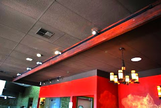 Photo: Sing Beams offer a classy atmosphere with track lighting. The torsion box sandwich core keeps the beams lightweight and straight. They have a strong, lightweight torsion box sandwich panel core, just like Sing Honeycomb Panels.