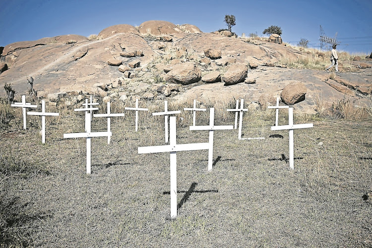 Crosses near Nkaneng informal settlement in Marikana , North West, where 34 miners were killed.