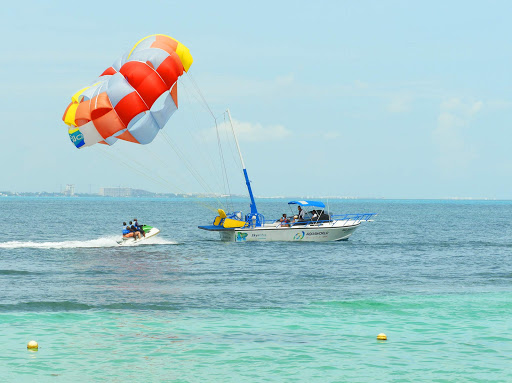 cancun-water-sports.jpg - Parasailing, jet skiing and snorkeling are among the water sports available along the beachfront in Cancun, Mexico.