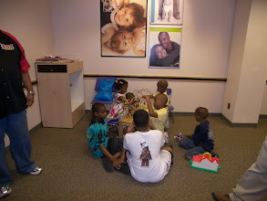 Photo: kids playing at Sears as we wait to take pictures.