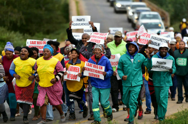Residents from Hankey and surrounding areas march to the Hankey Magistrate's Court where a man appeared after the attack of a woman in her home last month
