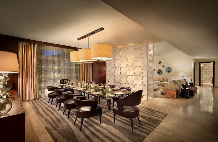 The One&Only's presidential suite includes a large, semi-open-plan dining and lounge area.