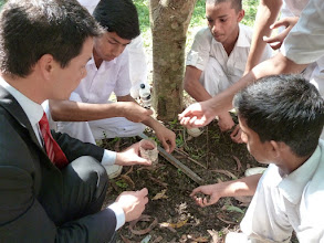 Photo: planting beans with some kids for a international science project. My students in London planted beans in similar conditions.