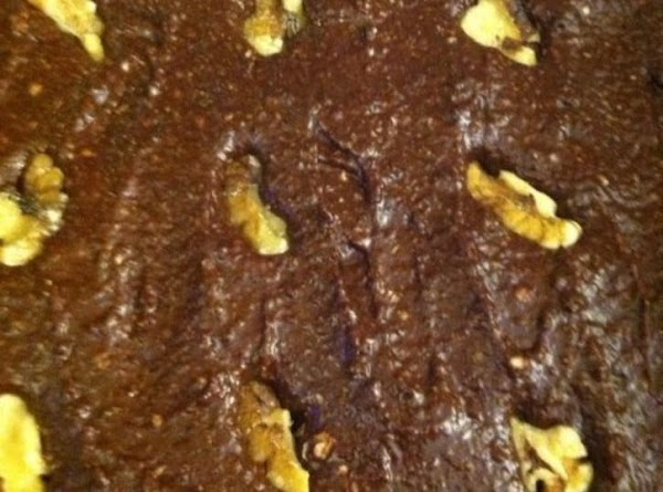 Beat the butter,sugar,egg,apple sauce,and vanilla together.Slowly add the cocoa and flour a little at...