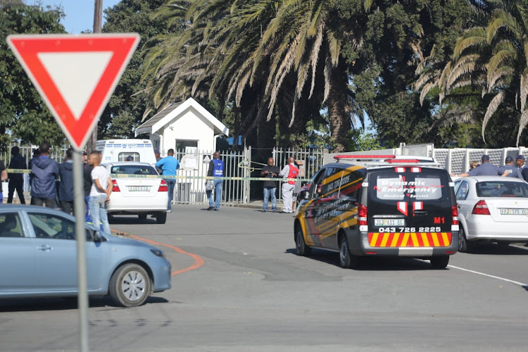 Emergency services and police outside Voorpos Primary School yesterday where a man allegedly shot and killed a woman