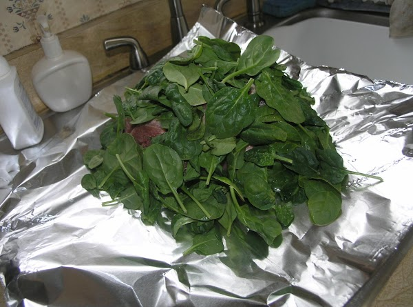 Lay out a large piece of heavy-duty aluminum foil, and place leaves on top....