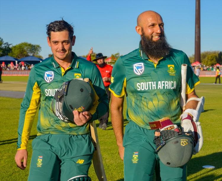 Quinton de Kock and Hashim Amla of South Africa after their record breaking innings during the 1st Momentum ODI match between South Africa and Bangladesh at Diamond Oval on October 15, 2017 in Kimberley, South Africa.
