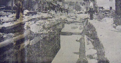Photo: Main Street in Winsted was literally torn apart by flood waters.