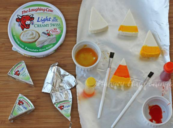 Cut Laughing Cow cheese rounds into desired sized wedges using a sharp paring knife.