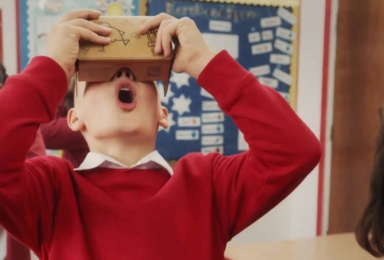 A student gapes mouth opened while using the Expeditions app in VR mode with Cardboard.