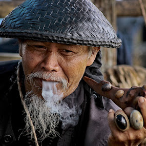 He is a Snake Charmer by Hindra Komara - People Street & Candids ( grandfather, candid, professional people, people, portrait )