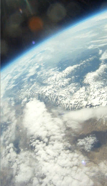 Photo: The Sierra's over California with a layer of clouds.