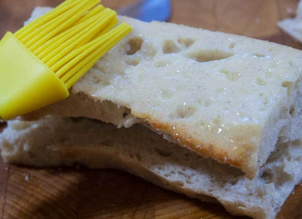Brush the melted butter on the bottom and two cut sides.