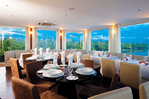 Aria-dining-room - Guests can enjoy the dynamic passing landscapes in the dining room of Aria on an Avalon cruise.