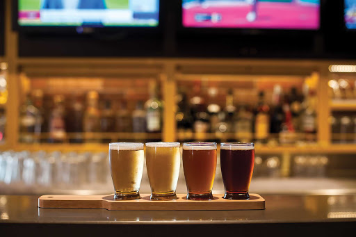 A flight of four draft beers awaits at Playmakers Sports Bar.
