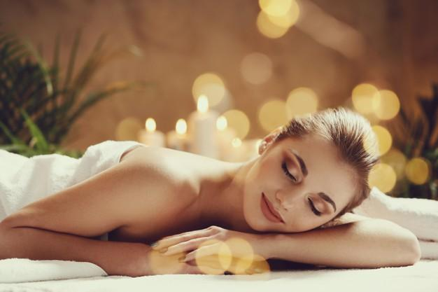Beautiful young woman lying and waiting for her massage. spa concept Free Photo