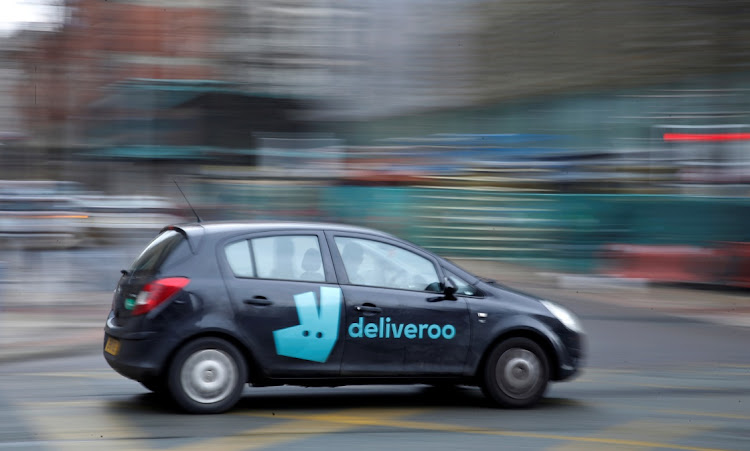 A deliveroo delivery driver in Manchester, Britain, March 8 2021. Picture: REUTERS/PHIL NOBLE