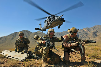 Photo: An HH-60G Pave Hawk hovers over pararescuemen and Brig. Gen. Jack L. Briggs, the 455th Air Expeditionary Wing commander, during a training mission at Bagram Airfield, Afghanistan, Sept. 24, 2010. The training mission provided a glimpse of what the 33rd Expeditionary Rescue Squadron brings to the fight and the capabilities it provides to combat commanders. (U.S. Air Force photo/Staff Sgt. Christopher Boitz)