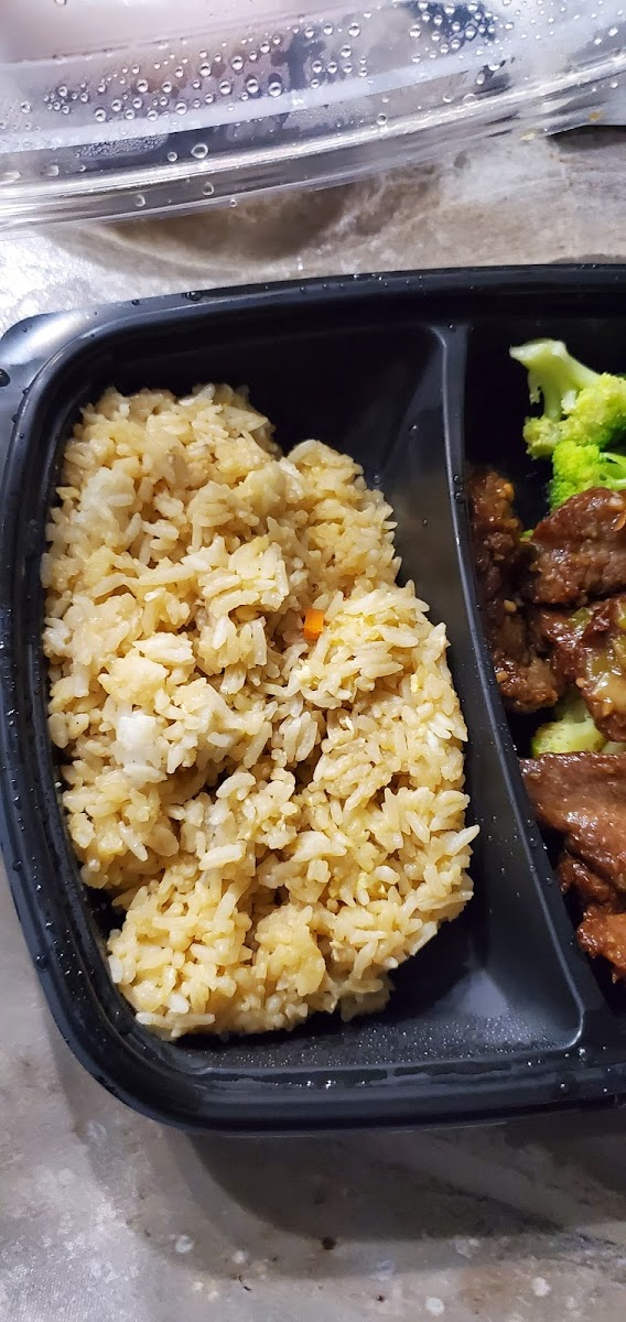 GF beef and broccoli, with wrong rice (suppose to be brown rice... it's def white rice with ??)
