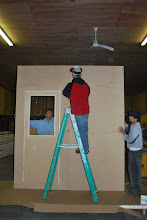 Photo: Have team members hold panels upright while you fasten them.