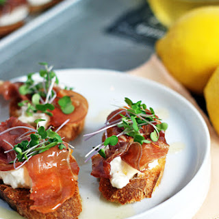 Prosciutto Crostini with Burrata and Lemon Honey Drizzle.