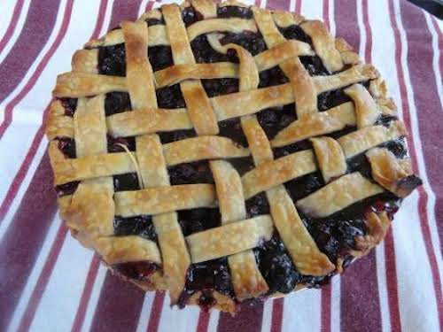 """Simple, Very Blueberry Flavored Pie """"One bite of this scrumptious pie, and..."""