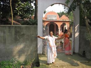 Photo: Sri Brajabandhu Brahmachari and a visitor at the entrance door