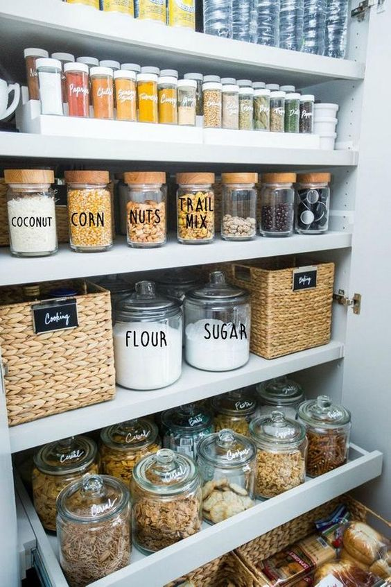 diy pantry organization with white jars, custom labels, matching spices and pull out drawers