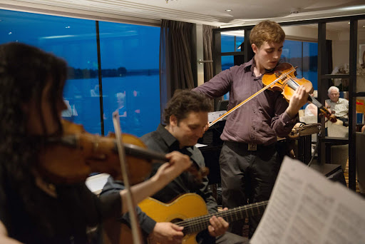 Musicians perform in the Panorama Lounge aboard Avalon Artistry II.