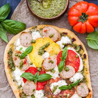 Grilled Tomato, Basil, Pesto Pizza with Chicken Sausage, Mozzarella and Ricotta.