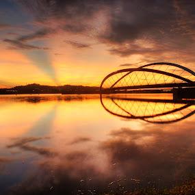 Glow Sunrise by Fadly Hj Halim - Landscapes Waterscapes ( reflection, putrajaya, dam, malaysia, lake, fadlyhalim, sunrise, slow shutter )