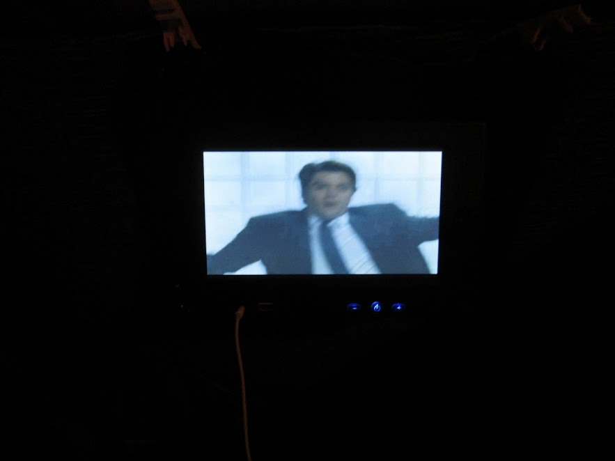 Watching movie on the bus.