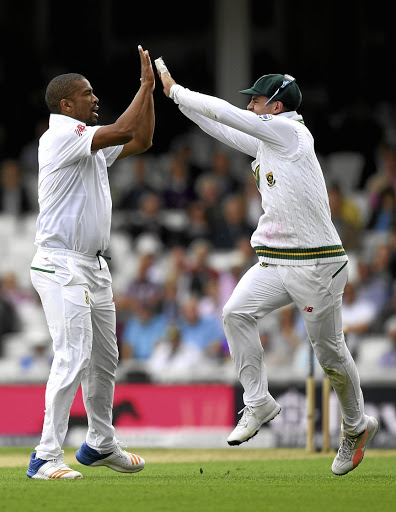 Root extraction: Vernon Philander celebrates with Heino Kuhn after getting the wicket of England captain Joe Root at The Oval on Thursday. Picture: SHAUN BOTTERILL/GETTY IMAGES