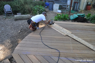 Photo: Brian cutting the radius for the IPE decking with a saw shoe guide.
