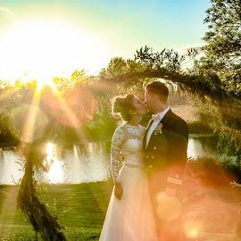 Sunset Burst Kiss by Debbie Slocum Lockwood - Wedding Bride & Groom