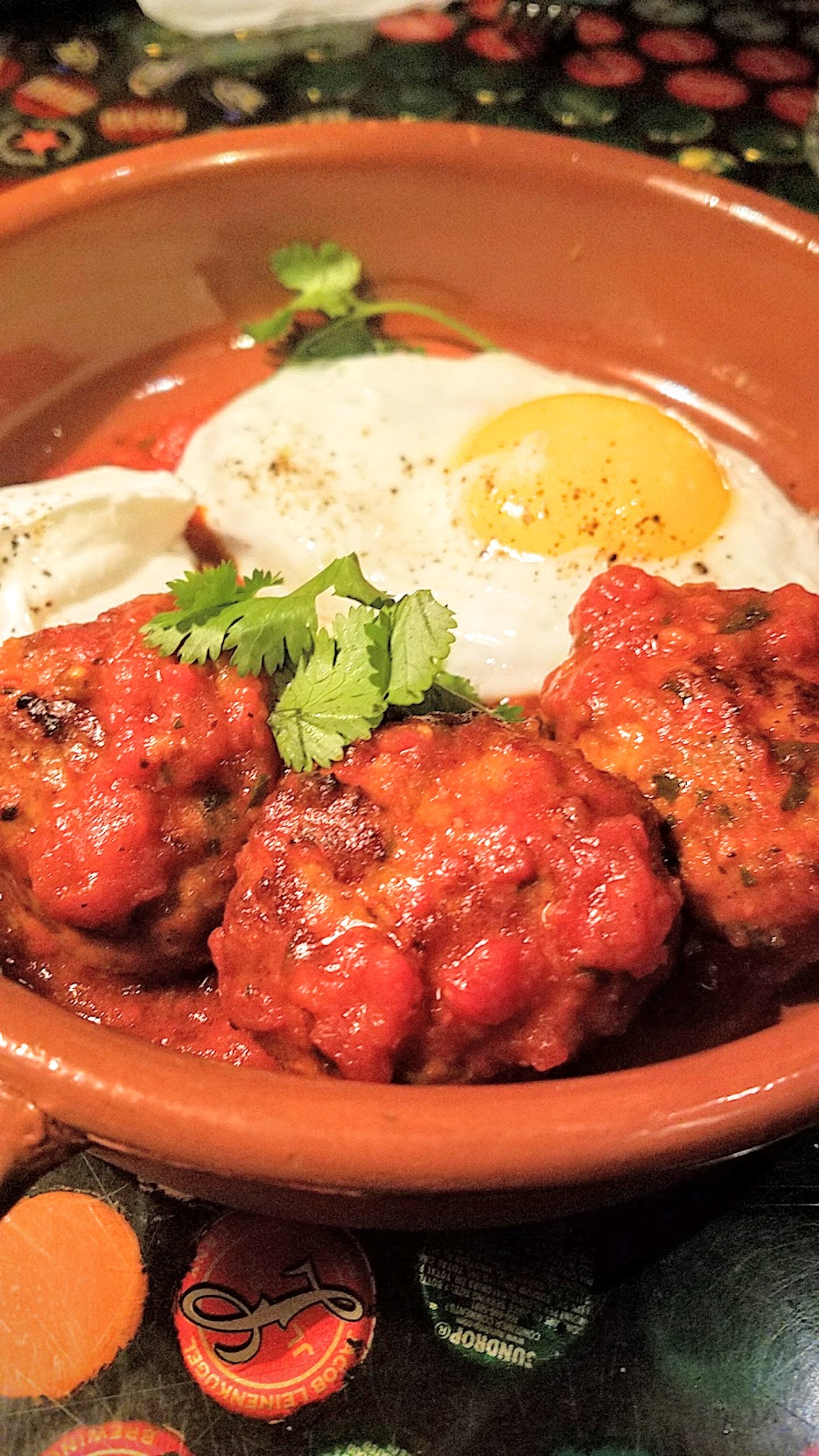 Example Food at Saraveza lamb meatballs with tomato sauce, yogurt, and sunny egg