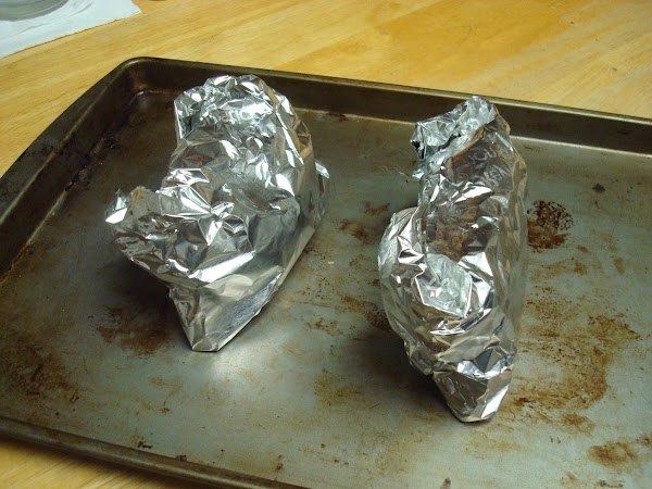 Wrap in aluminium foil and place on a baking sheet.