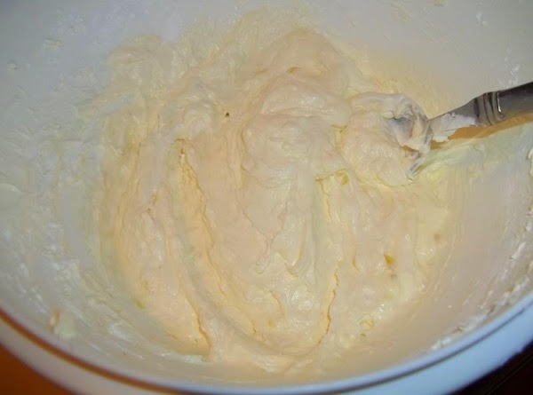 In a medium mixing bowl, combine cream cheese, powdered sugar, 1/2 of a sliced...