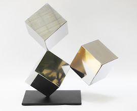 Photo: 18 REFLECTIONS - 19H X 22W X 9D Polished Stainless Steel, Painted Mild Steel, Rear View