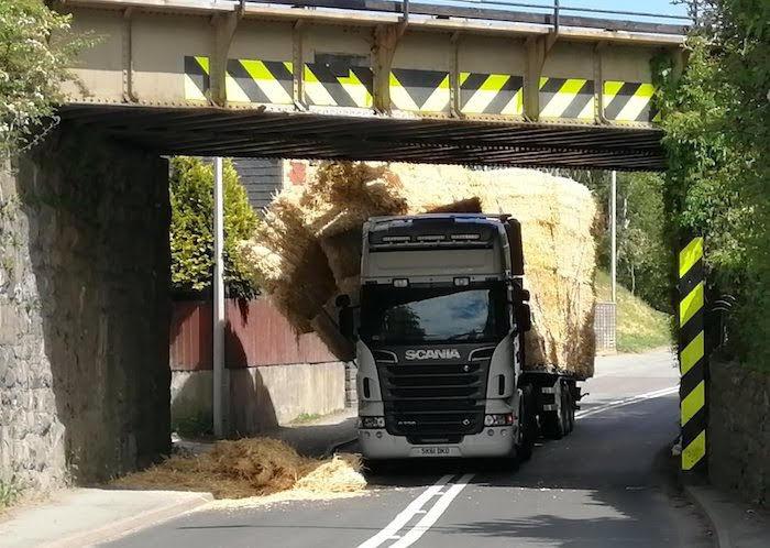 Lorry strikes railway bridge and blocks road