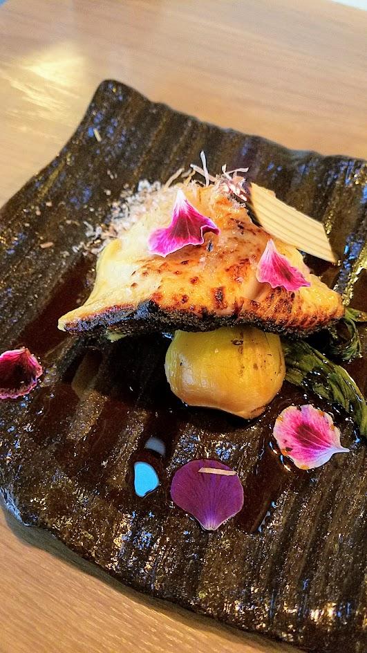 Afuri Irori and Robata Grill item of Gindara, saikyo marinated miso black cod with chili oil and bonito flake over dashi braised bok choy