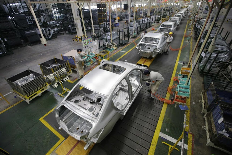 Employees assemble cars at a production line of Dongfeng Peugeot Citroen Automobile factory in Wuhan, Hubei province, in this February 13 2014 file photo. Picture: REUTERS/DARLEY SHEN