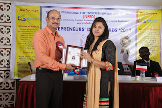 Photo: Chief Guest Mr. A. Devi Dutt Issuing Young Woman Entrepreneur Award to Ms. S. Motchapriya, Managing Director, Sri Gayathri Nature Cure Hospital, Coimbatore