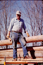 Photo: Fred working on last wall log.