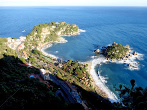 Photo: View of the sea shore and Isola Bella 500ft below Taormina town