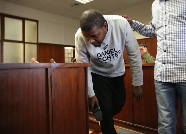 Petrol station hitman sentenced to life in jail