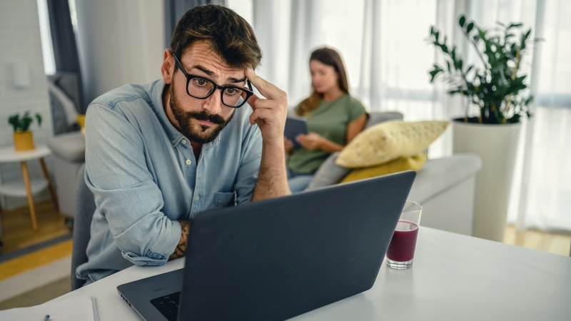 man working from home at the computer