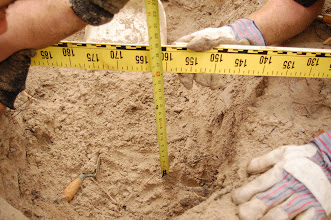 Photo: Recording depth below ground surface is basic archaeological practice.