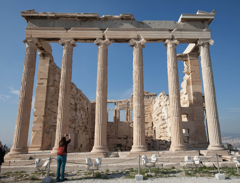The Erechtheion or Erechtheum. an ancient Greek temple on the north side of the Acropolis in Athens dedicated to Athena and Poseidon.